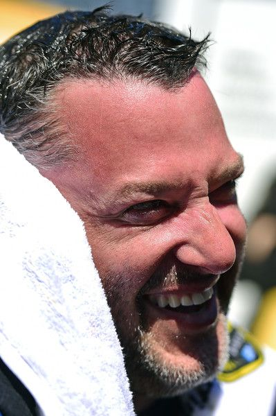 Tony Stewart Photos - Tony Stewart, driver of the #14 Code 3 Assoc/Mobil 1 Chevrolet, wipes his face in victory lane after winning the NASCAR Sprint Cup Series Toyota/Save Mart 350 at Sonoma Raceway on June 26, 2016 in Sonoma, California. - NASCAR Sprint Cup Series Toyota/Save Mart 350