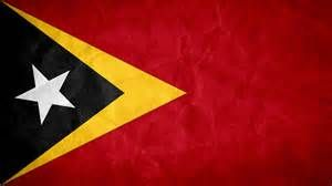 "The flag of East Timor was adopted in 2002, but the design has been in use since 1975.  It was first raised at midnight on May 19, replacing the U.N. flag as the country became independent. The yellow stands for ""the traces of colonialism in East Timor's history,"" the black ""the obscurantism that needs to be overcome,"" the red ""the struggle for national liberation,"" the star as a guiding light and the white for peace."