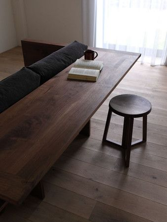 The Caramella Counter Sofa in walnut by Japanese brand Piano Isola.