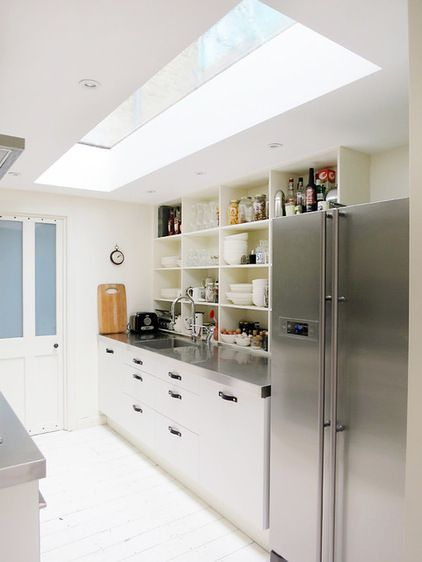 In this London townhouse a large skylight dramatically brightens a windowless kitchen.  With skylights there can be a greater risk of leakage simply because of the larger hole cut in your roof. Another consideration is the heat they can generate.