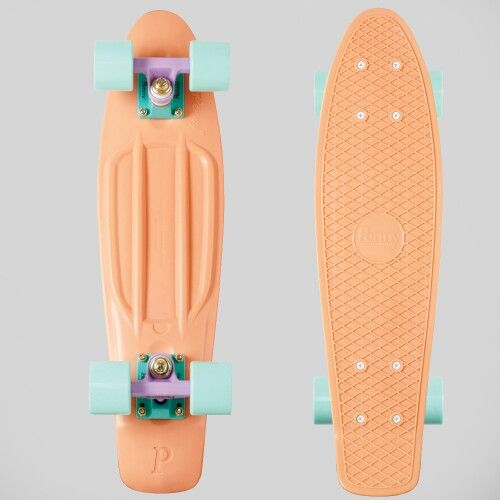Penny board in peach w/ mint blue wheels.