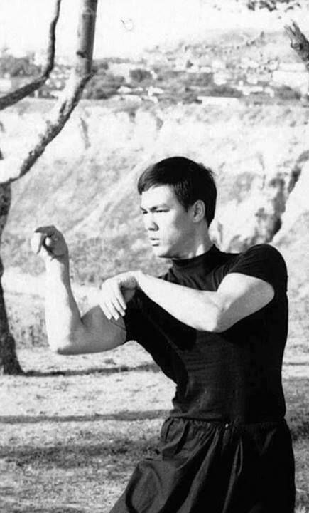 While we never got to see Bruce Lee in any traditional old school films, it makes it finding rare pictures of him practicing praying mantis kung fu forms even better. 'In memory of a once fluid man, crammed and distorted by the classical mess.'