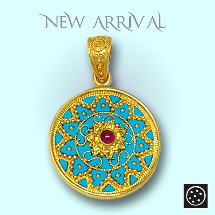 A new 18K solid gold and turquoise hot, vitreous enamel large pendant with ruby. Check out the link for more details.