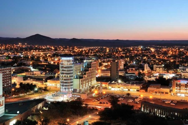WINDHOEK (NAMIBIA) ::: is the capital and largest city of the Republic of Namibia. It is located in central Namibia in the Khomas Highland plateau area, at around 1,700 metres (5,600 ft) above sea level. The city is the major commercial and financial center of Namibia. Windhoek is situated in a semi-arid climatic region. Days are mostly warm with very hot days during the summer months, while nights are generally cool. The average annual temperature is 19.47 °C (67.05 °F).