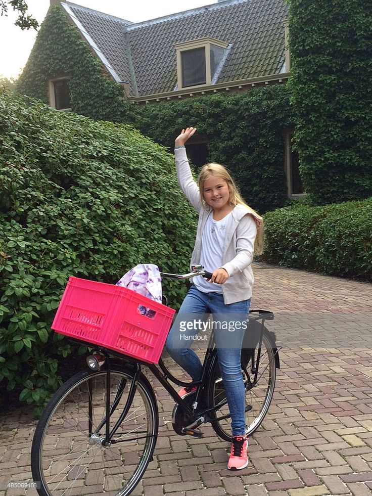 In this handout provided by Netherlands Government Information Service, Crown Princess Amalia of The Netherlands waves on her first day of attending Christelijk Gymnasium Sorghvliet high school on August 24, 2015 in Wassenaar Netherlands.
