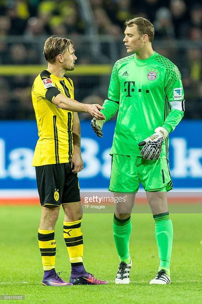 Marcel Schmelzer of Borussia Dortmund and goalkeeper Manuel Neuer of Bayern Muenchen looks on during the Bandesliga soccer match between BV Borussia Dortmund and FC Bayern Muenchen at the Signal Iduna Park in Dortmund, Germany on November 19, 2016.