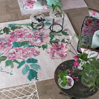 A special and sensational hand-knotted rug, combining oriental florals in lustrous hand-spun bamboo, with a charming sandalwood pure wool background. A statement for your floor with key notes of fuchsia pink and lime green together creating a very uplifting character.