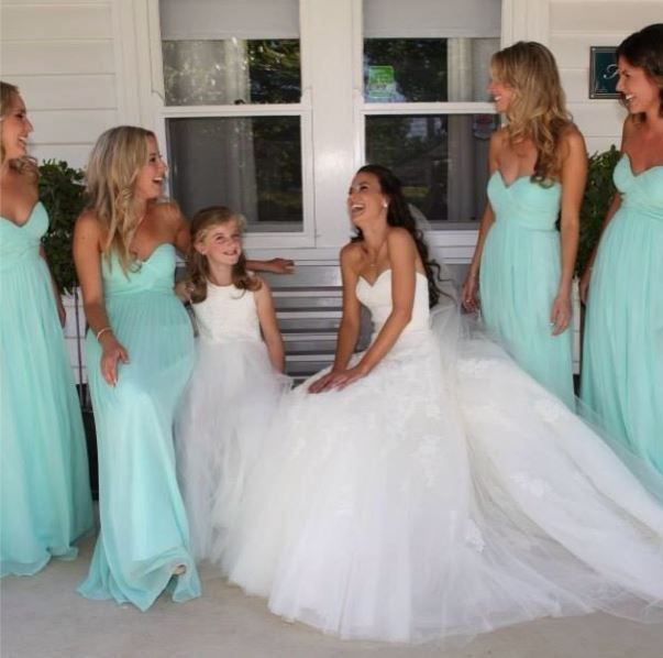6603c05007 Beautiful bridesmaids in  Spearmint Donna Morgan Collection dresses! Submitted  by Raschelle Osborne.