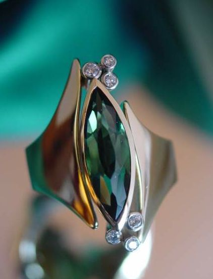 Custom cut long marquise tourmaline & diamond in gold by Robert Schock