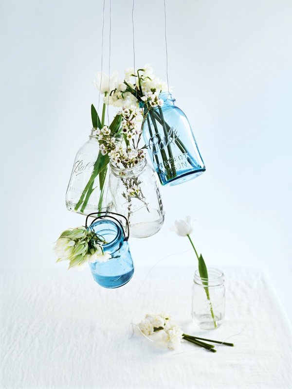 """""""It's so easy to create a beautiful centrepiece. These vintage jars suspended with wire are so sweet and elegant."""" Pinner: Donna Hay, cookbook author. Photography: William Meppem."""