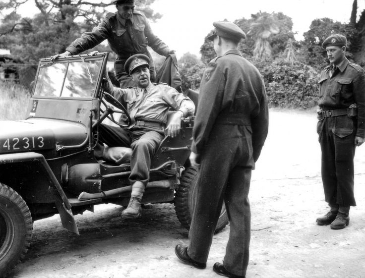 Lieutenant General Henry Duncan Graham 'Harry' Crerar, 1888-1965 commander of the 1st Canadian Army arriving with a army jeep 'Willis' at headquarters in Public Relations in France. The officer standing with his back to the photographer - Lieutenant Malone .Image