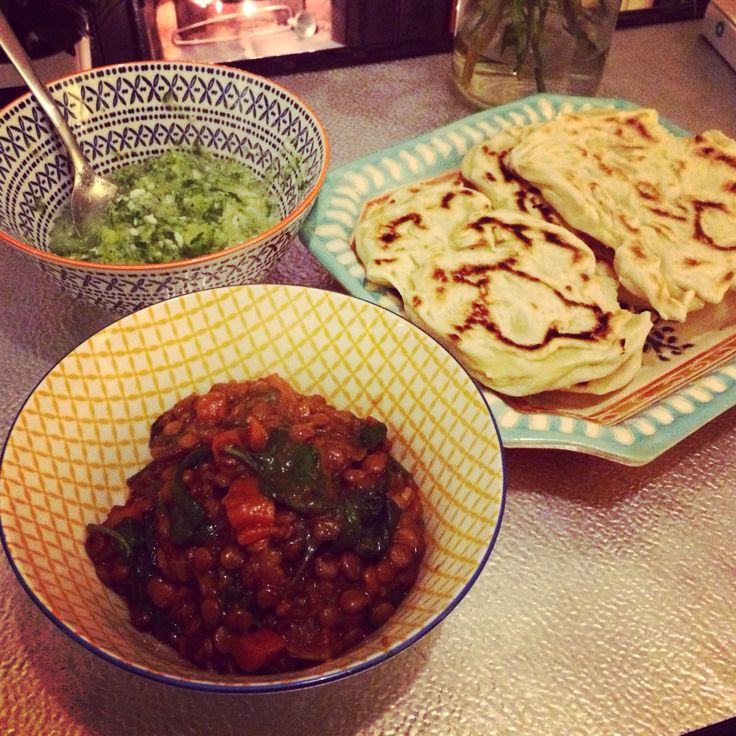 Vegan green lentil and spinach curry with cucumber and coconut dressing and flat breads.
