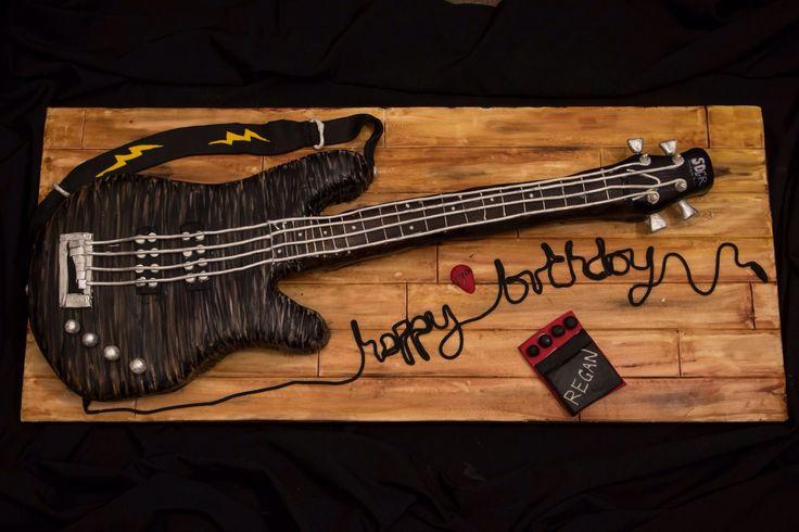 Bass guitar cake on wood effect board