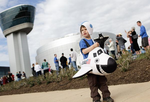 Wearing a space shuttle costume, four-year-old Alex Mendez, of Sterling, Virginia, awaits the arrival of the space shuttle Discovery at the National Air and Space Museum's Steven F. Udvar-Hazy Center on Tuesday.