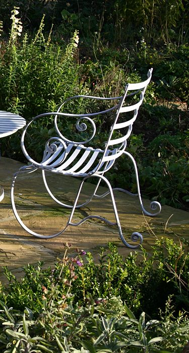 garden metal furniture. metal garden furniture and plant obeliscs architectural old cast iron windows