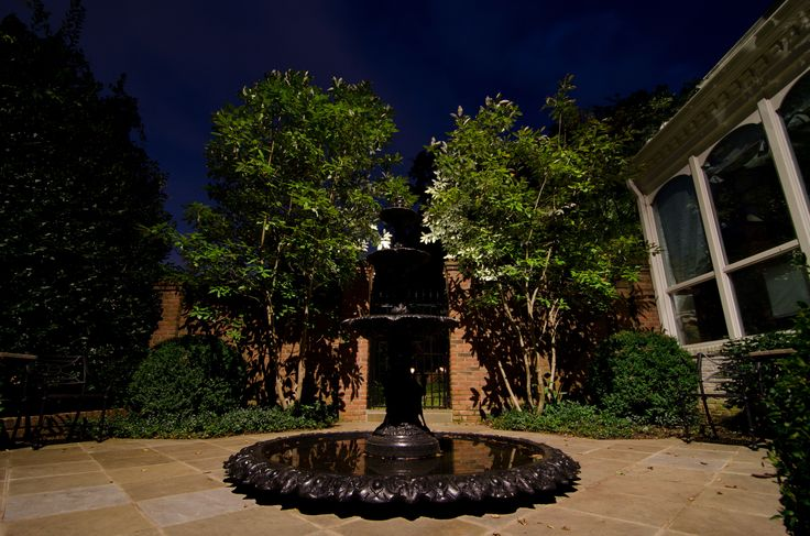 This elegant fountain becomes a focal point of the evening landscape with the addition of outdoor lighting.