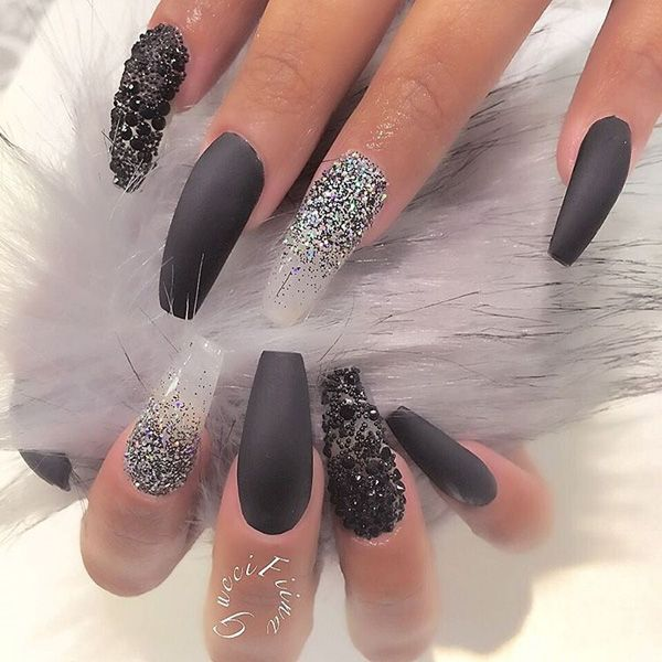 Add black and white glitters and black beads for your coffin nail art. But to subtle it down a bit, you can simply use matte black nail polish on other nails.