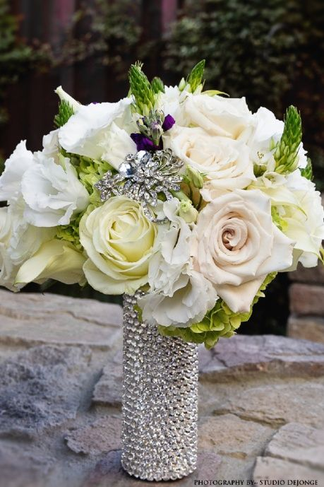 Bridal Bling with crystal encrusted bridal bouquet handle~ vintage style brooches, champagne roses, white roses, white lisianthus, purple stock, green hydrangea, white miniature calla lilies, star of bethlehem.  Handmade handle by http://www.panachebride.com/