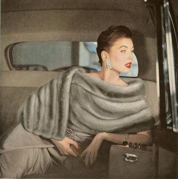 Being A Woman means arriving in style: Suzy Parker in an Emba mink stole and a gown by Ceil Chapman…