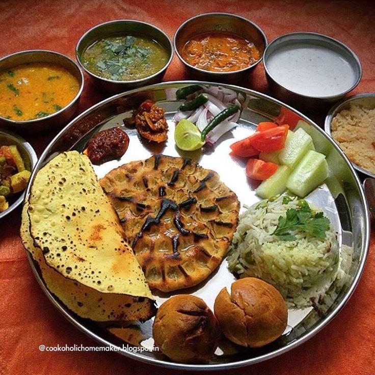 Rajasthani Thali: Marwari Thali! Daal Baati, Gatta curry, Masala dahi, Methi Dana Papad ki sabzi, Mix veg, Matar Pulao, Khoba roti, lehsun mirchi ki chutney (garlic red chilly chutney) Sooji ka halwa, Papad with some salad and pickle