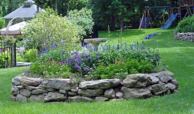 """Natural Stone raised bed:  """"This raised bed is edged with irregular sized granite."""""""