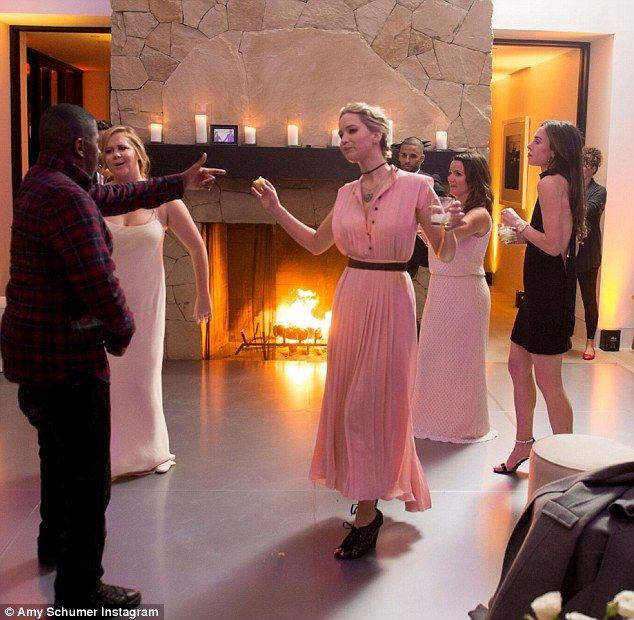 Having a blast! Jennifer Lawrence let loose at Amy Schumer's wedding reception on Wednesda... #jenniferlawrence