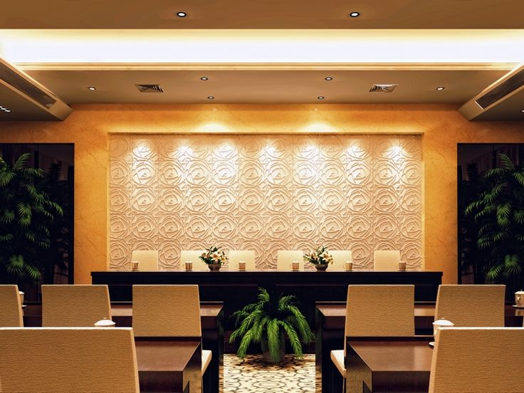 """A commercial conference room emitting a lovely visual effect with a """"Peony"""" feature wall."""