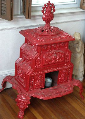 late 1800's Victorian Era red cast iron parlor stove, made in Troy New York
