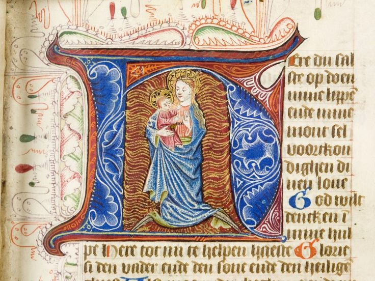Fol. 18r, initiaal. Meesters van de Haarlemse Bijbel, Maria gekleed in de zon