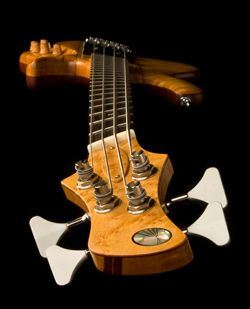 """This fanned fret 4-string is based on Little Guitar Works Torzal """"Standard"""" model, which is a neck-through construction with a 35° twist in the neck.  From the """"zero"""" plane of the body, that total twist consists of 20° downward rotation at the nut and 15° upward rotation at the bridge."""
