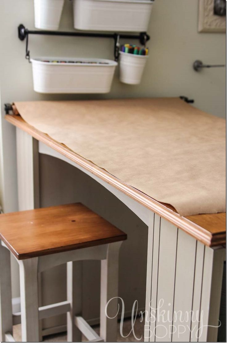 Crafts table with storage - Attach A Roll Of Craft Paper From A Curtain Rod On The Wall Over Craft Table