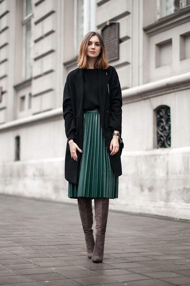 Green pleated skirt in midi length