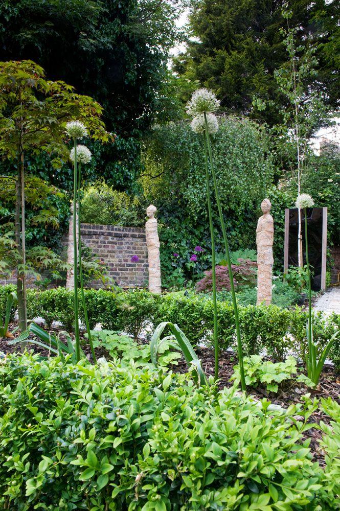 alliums and statues Garden Design North London