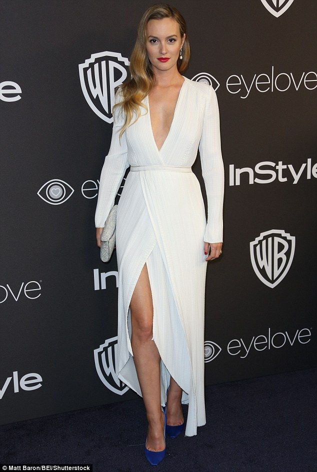 She's a bit of all-white:Formed of classy crepe material, the frock cinched in at her env...