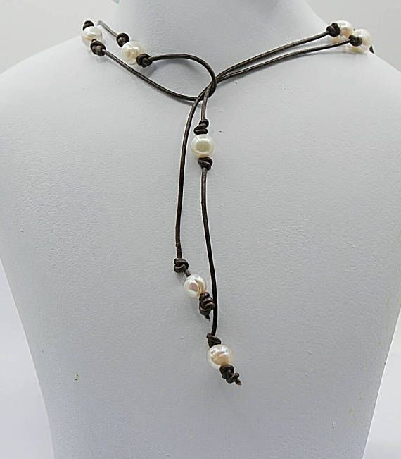 Pearl and Leather long lariat wrap necklace has freshwater pearls that are randomly knotted on this 46 inch long leather wrap necklace. A Rustic Bohemian necklace sure to make a statement while wearing casual to work clothing. These pearls are of an organic shape and not