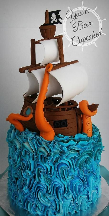 """The theme for this birthday cake was """"Pirates"""" but my client was excited that I wanted to make a ship being attacked by a giant octopus. I had SO much fin making this cake. Aside from the skewer-supports holding up the masts, everything is edible...."""