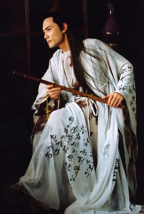 Tang Dynasty Poet costume worn by men. He is also holding a traditional Chinese flute.