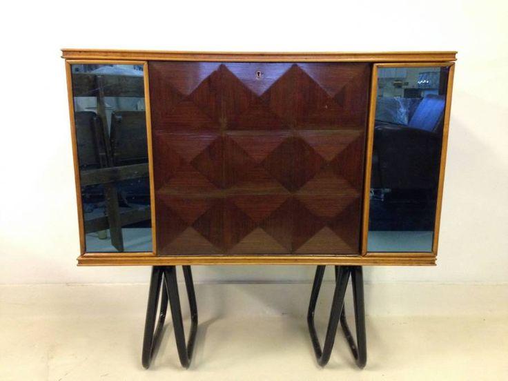 Italian bar cabinet Geometric front panel Blue glass sides Black legs Mirrored interior