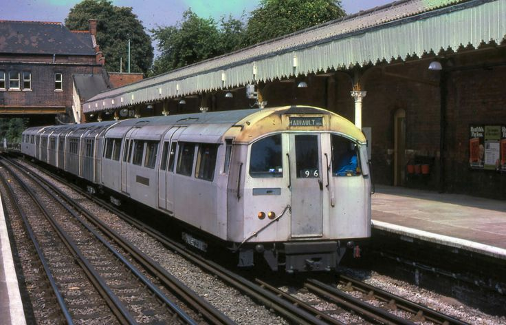 1960 Tube Stock at Chigwell clearly showing the standard stock trailer cars in the middle   Flickr - Photo Sharing!