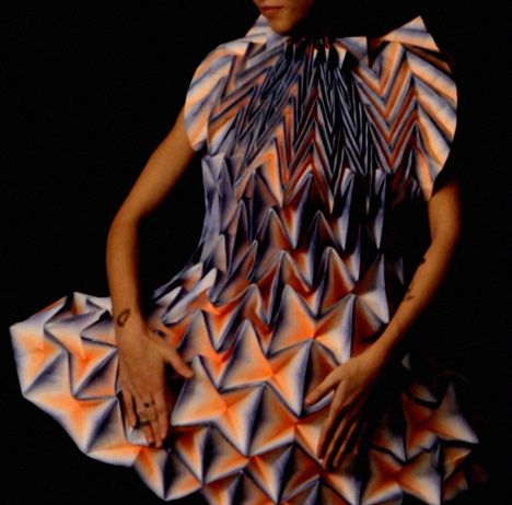 German designer Jule Waibel has created 25 of her folded paper dresses for fashion brand Bershka's shop windows around the world