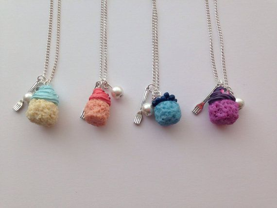 Handmade jewellery by Charmingly Kitsch on Etsy.  Four cute cupcake necklaces adorned with a small fork charm and a glass pearl.