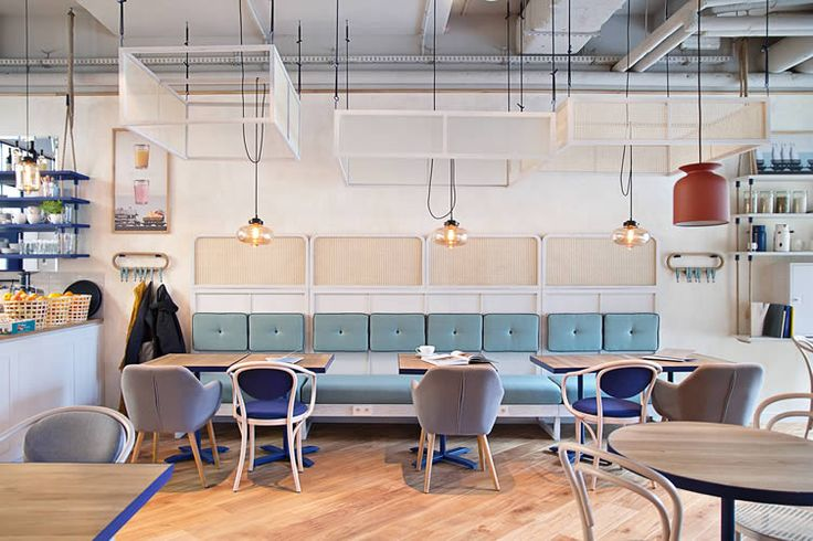Bright and breezy seaside feel of Baltic Poland translated into a stylish crepe café by local design studio...