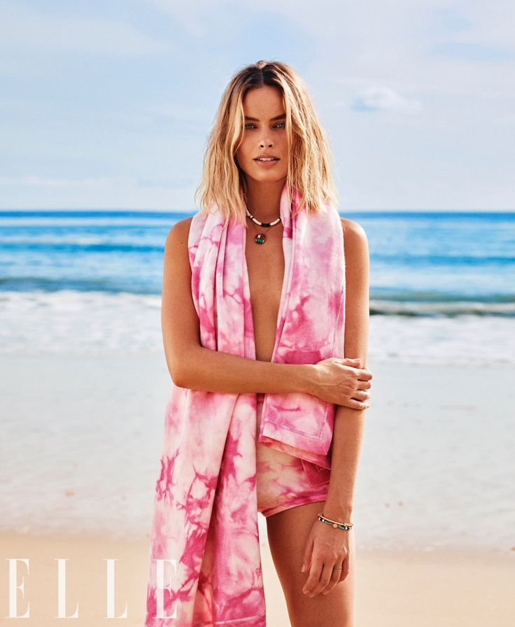 Posing at the beach, Margot Robbie wears Michael Kors Collection blanket and briefs
