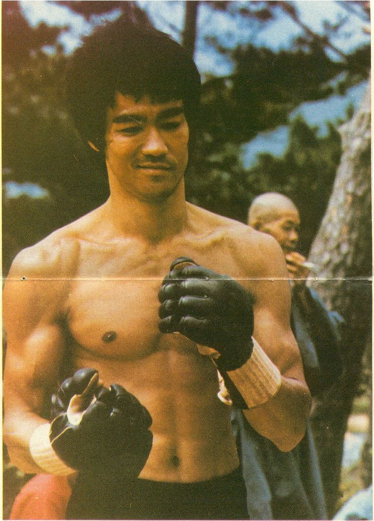 Bruce Lee in the kendo gloves from Enter the Dragon. Anyone who questions that he is the father of MMA, just watch the first scene of that movie. If anyone questions his chops as a philosopher and traditional martial artist, watch the second scene.