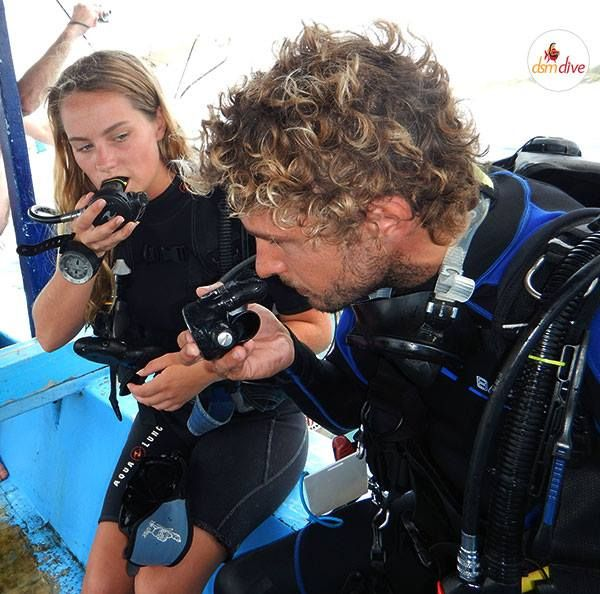 Instructor Paul is demonstrating to his student how to use a regulator