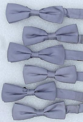 A job lot of 6 classic and discreet silver silk bow ties suitable for formal occasions like weddings or evening functions or as theatrical or dance