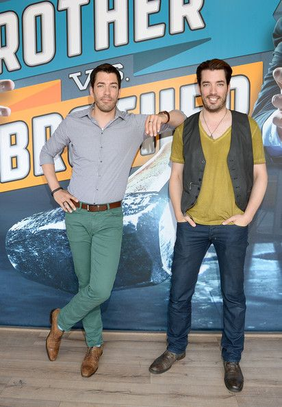 Jonathan Scott Drew Scott Photos Photos - Drew Scott (L) and Jonathan Scott of Property Brothers pose at HGTVs The Lodge at CMA Music Fest 2014 on June 7, 2014 in Nashville, Tennessee. - HGTV'S The Lodge At CMA Music Fest - Day 3