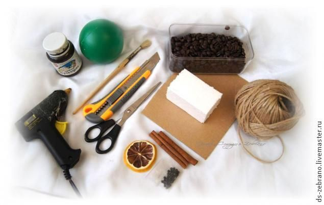Plastic ball or foam ball Brown paint Paint brush Box cutter Scissors Jute twine Coffee beans Piece of foam for muzzle Cardboard Cinnamon Dried Lemon  Beady black eye