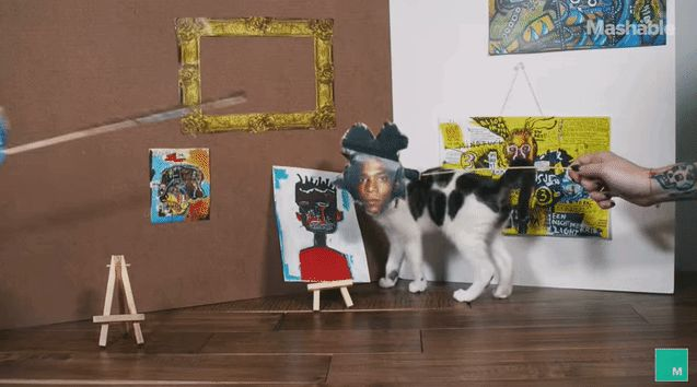 Kitten don artist masks and create their own versions of famous art pieces.