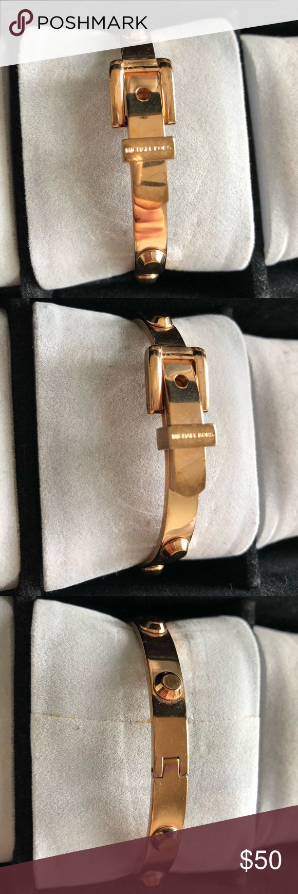 Michael Kors Studded Buckle Bracelet Michael Kors studded buckle bracelet in rose gold. Lightly tarnished on the side opposite of buckle. Scratches all around from normal wear. Three notches to adjust size. Michael Kors Jewelry Bracelets